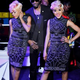 Anthony Minott Bounty Killer flanked by twin act K-Queens at his birthday celebrations.