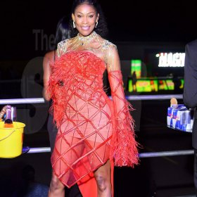 Anthony Minott  Bounty Killer's lady love Claudia Rattigan commands the spotlight in a show stopping red number.