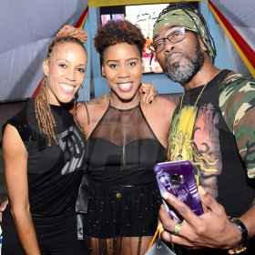 Rudolph Brown/ Photographer<\n>The host for Charles Chocolates Dancin' Dynamites, Kim Weezy (centre), is flanked by the competition's judges Kerry-Ann Henry (left) and Orville Hall.<\n><\n>