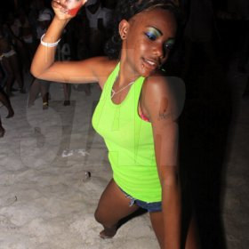 Anthony Minott/Freelance Photographer  Scenes during Double Shotts beach party held at Sugarman's Beach, Hellshire, Portmore, St Catherine.