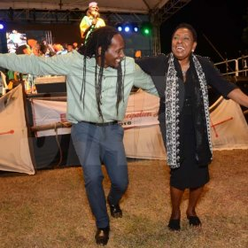Shorn Hector/Photographer  From LeftMinister of State in the Ministry of Culture, Gender, Entertainment and Sport, Alando Terrelonge, Minister of Culture, Gender, Entertainment and Sport, Olivia Grange dancing together at the Seville Emancipation Jubilee 2018