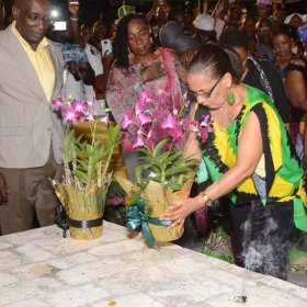 Shorn Hector/Photographer  Minister of Labour and Social Security, Shahine Robinson lays a floweral arrange on the tomb of Africans who are buried on site at the Seville Emancipation Jubilee 2018