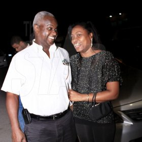 Anthony Minott/Freelance Photographer Garfield Lettman, National Sales Manager for Wray and Nephew Jamaica Limited shares a light moment with his lady friend during businessman, Lester 'Father Ken' Crooks birthday party at Ken's Wildflower Sports Bar and Lounge, Portmore Plaza, Port Henderson Road, recently.