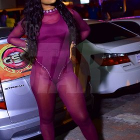 Dancer Danii Boo pose for the camera in a purple outfit designed by Nash Wear
