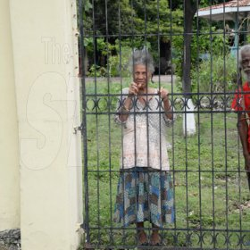 Jermaine Barnaby/Freelance PhotographerThese two senior citizens take a peek s at Jamaica carnival road march on Sunday April 23, 2017 while they travelled along Hope road.