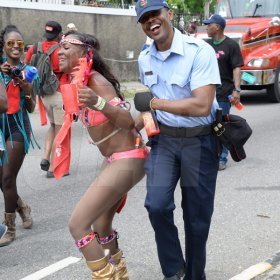 Jermaine Barnaby/Freelance PhotographerA reveller busing a dance on a police officer at Jamaica carnival road march on Sunday April 23, 2017.