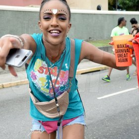 Jermaine Barnaby/Freelance Photographer Lets 'Make Carnival Great Again' Revellers at Jamaica carnival road march on Sunday April 23, 2017.