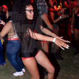Jermaine Barnaby/Freelance Photographer A female dancer showing off some dance moves before entering the Magnum live concert held at Sabina Park on Saturday January 7, 2017.