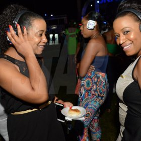 Rudolph Brown/Photographer Lovely twins Racquel Watson, (right) and Rochelle Rowe dancing at Quiet party at Devon House on Friday, December 11, 2015