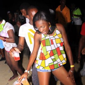 Anthony Minott/Freelance Photographer  Patrons dance during Rumbar Bubbles fourth anniversary beach party held at Fantasy Beach, Priory, St Ann last Saturday. Over 5,600 patrons flocked the venue.