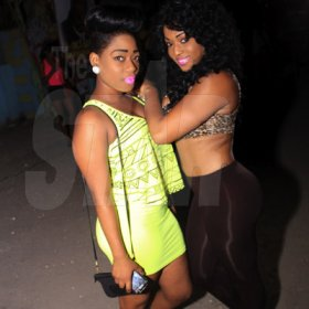 Anthony Minott/Freelance Photographer Dancers, Dancehall Queen 2012, Sher (right), and close friend, Rene Six-thirty share lens during Pon Di Spot Fridayz, Drewsland, in St Andrew recently.