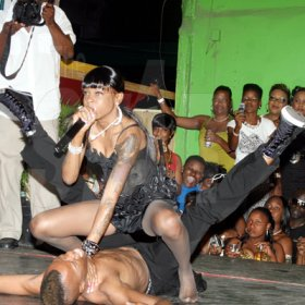 Nathaniel Stewart/Freelance Photographer                                                                                                                Lisa Hyper pins Shebada to the ground during her performance