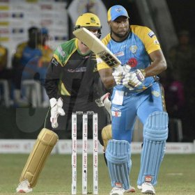 Ian Allen/PhotographerKeiron Pollard playing for the St. Lucia Stars versus the Jamaica Tallawahs during the Caribbean Premier League (CPL) T/20 cricket match at Sabina Park on Tuesday.Wicket Keeper Glen Phillips looks on.
